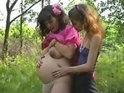 Pregnant lesbian has fun in forest