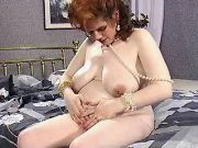 Redhead pregnant girl shows belly
